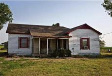 """The boyhood home of country music star Johnny Cash is shown in this undated publicity photo released to Reuters October 3, 2012. Cash's humble home in the tiny town of Dyess, Arkansas, was acquired in 2011 by Arkansas State University, which is spearheading the drive to repair and furnish the 1930s era house where the """"Ring of Fire"""" singer grew up with his six brothers and sisters. REUTERS/Arkansas State University/Handout"""