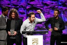 Drummer Ronnie Vannucci Jr. of the rock band The Killers gestures as the band receives the Vanguard Award at the 27th annual ASCAP Pop Music Awards at the Renaissance Hollywood Hotel in Hollywood, California April 21, 2010. REUTERS/David McNew
