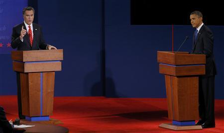 President Barack Obama (R) listens as Republican presidential nominee Mitt Romney speaks during the first presidential debate in Denver October 3, 2012. REUTERS/Brian Snyder