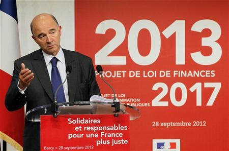 France's Finance Minister Pierre Moscovici presents France's 2013 budget during a news conference at the Bercy Finance Ministry in Paris September 28, 2012. REUTERS/John Schults