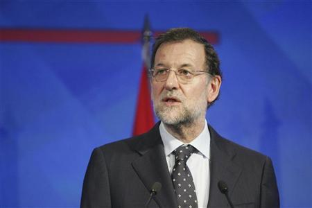 Spain's Prime Minister Mariano Rajoy speaks after meeting his Moroccan counterpart Abdelilah Benkirane in Rabat October 3, 2012. REUTERS/Stringer