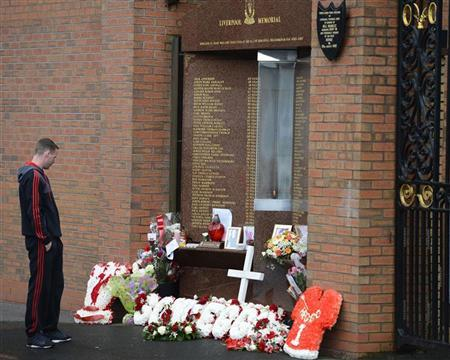 A man looks at flowers laid at a memorial to 96 fans killed at the Hillsborough disaster in 1989, at the Anfield soccer stadium in Liverpool, northern England September 12, 2012. REUTERS/Nigel Roddis