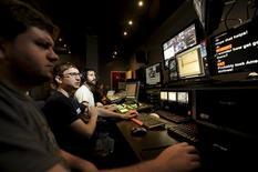Crew members produce an episode of Tekzilla at Revision3 in San Francisco, California October 3, 2012. REUTERS/Noah Berger