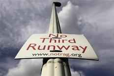 A sign protesting against a third runway is seen in the village of Sipson near Heathrow Airport in west London August 28, 2012. REUTERS/Stefan Wermuth