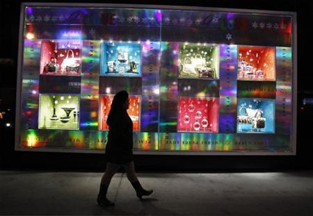 A pedestrian walks past holiday window decorations outside of Bloomingdale's department store in New York December 8, 2010. REUTERS/Lucas Jackson
