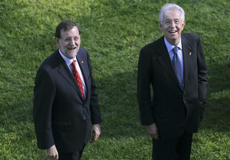 Italy's Prime Minister Mario Monti (R) and Spain's Prime Minister Mariano Rajoy walk together after European and North African leaders gathered for a family photo as they met in Valletta for a summit of Mediterranean neighbours, October 5, 2012. REUTERS/Philippe Wojazer