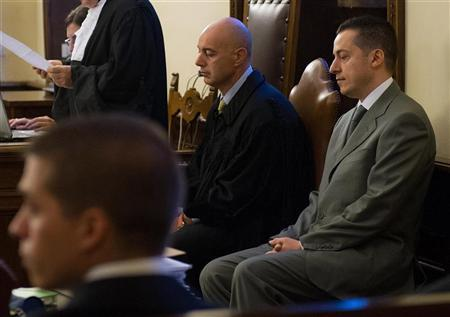 Pope Benedict's former butler Paolo Gabriele (R), accused of stealing and leaking the pontiff's personal papers, sits at the start of his trial at the Vatican September 29, 2012. GREUTERS/Osservatore Romano