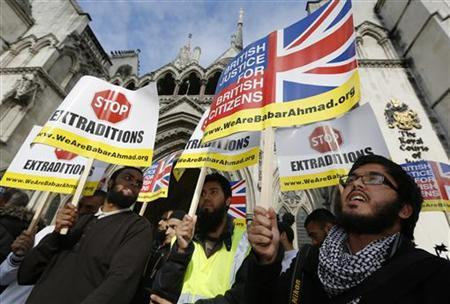 Demonstrators protest in support of Islamist cleric Abu Hamza al-Masri, who is appealed against his extradition to the U.S., outside the High Court in London October 5, 2012. REUTERS/Luke MacGregor/Files