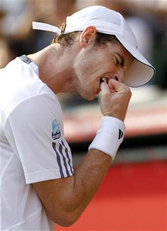 Andy Murray of Britain reacts after missing a shot against Milos Raonic of Canada during their men's singles semi-finals match at the Japan Open tennis championships in Tokyo, October 6, 2012. REUTERS/Yuriko Nakao