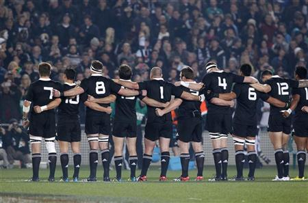 The All Blacks link arms as they sing the national anthem for their test match against Ireland at Eden Park in Auckland June 9, 2012. REUTERS/Nigel Marple