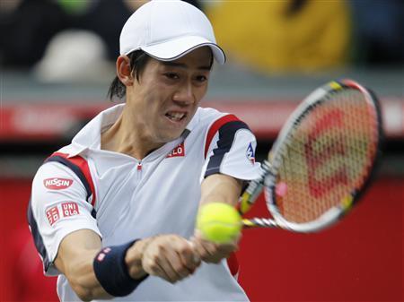 Kei Nishikori of Japan returns a shot to Milos Raonic of Canada during the men's singles finals match at the Japan Open tennis championships in Tokyo, October 7, 2012. REUTERS/Yuriko Nakao
