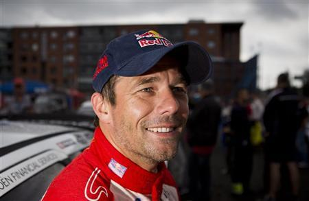 Sebastien Loeb smiles during the last day of the FIA World Rally Championship WRC Neste Oil Rally Finland at the service area in Jyvaskyla August 4, 2012. REUTERS/Roni Rekomaa/Lehtikuva