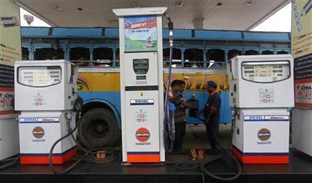 An employee fills diesel in a public bus at a fuel station in Kolkata August 13, 2012. REUTERS/Rupak De Chowdhuri/Files