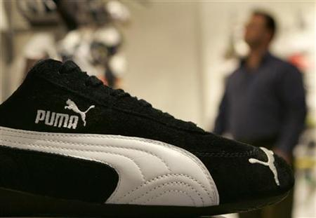 A customer looks at some shoes in the Puma factory outlet store in Herzogenaurach near Nuremberg April 10, 2007. REUTERS/Michaela Rehle/Files