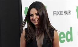 """Cast member Mila Kunis poses at the premiere of """"Ted"""" at the Grauman's Chinese theatre in Hollywood, California June 21, 2012. The movie opens in the U.S. on June 29. REUTERS/Mario Anzuoni"""