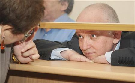 Vladimir Kozlov, leader of the unofficial Alga! party, looks out from a glass-walled cage during his trial in the Kazakh city of Aktau October 8, 2012. REUTERS/Olga Yaroslavskaya