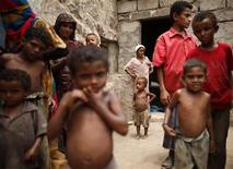 Children gather in a poor neighbourhood in the Mawzaa village of the southern Yemeni province of Taiz July 1, 2012. REUTERS/Khaled Abdullah