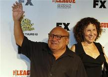 """Actor Danny DeVito and his wife Rhea Perlman arrive at the premiere screening of the FX cable television series """"It's Always Sunny in Philadelphia"""" in Hollywood September 13, 2011. REUTERS/Fred Prouser (UNITED STATES - Tags: ENTERTAINMENT)"""