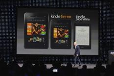 """Amazon CEO Jeff Bezos walks off after unveiling the Kindle Paperwhite, Kendle Fire HD 8.9"""" and 7"""" during Amazon's Kindle Fire event in Santa Monica, California September 6, 2012. REUTERS/Gus Ruelas"""