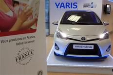 A Toyota Yaris Hybrid car is displayed in the show room at the Toyota car assembly plant in Onnaing, northern France, October 8, 2012. Japan's Toyota Motor Corp announced a massive recall on October 10 to fix malfunctioning power window switches, saying it will pull back 7.43 million vehicles worldwide in the biggest single recall since 1996, performed by Ford Motor Co. Picture taken October 8, 2012. REUTERS/Pascal Rossignol