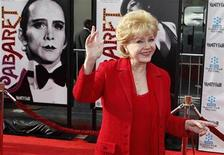 """Actress Debbie Reynolds arrives at the world premiere of the 40th anniversary restoration of the film """"Cabaret"""" during the opening night gala of the 2012 TCM Classic Film Festival in Hollywood, California April 12, 2012. REUTERS/Fred Prouser"""