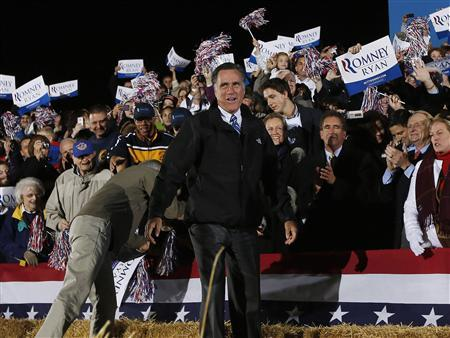 Republican presidential nominee Mitt Romney smiles as he arrives at a campaign rally outside the Cuyahoga Falls Natatorium in Cuyahoga Falls, Ohio October 9, 2012. REUTERS/Shannon Stapleton