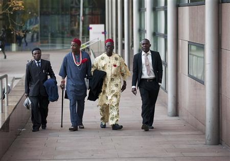 Friday Alfred Akpan (L), Eric Dooh (2nd L), Chief Fidelis Oguru (2nd R) and Alali Efanga (R), all representatives of farmers from Nigeria arrive at a local court in The Hague October 11, 2012. REUTERS/Michael Kooren