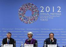 (L-R) Poland's Central Bank Governor Marek Belka, International Monetary Fund (IMF) Managing Director Christine Lagarde and World Bank Group President Jim Yong Kim attend their joint news conference at the annual meetings of the IMF and the World Bank Group in Tokyo October 13, 2012. REUTERS/Kim Kyung-Hoon (