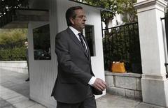 Greek Prime Minister Antonis Samaras walks towards his office in Athens shortly after arriving in Greece October 5, 2012. REUTERS/Yorgos Karahalis