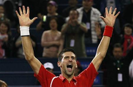 Novak Djokovic of Serbia celebrates after winning the men's singles final against Andy Murray of Britain at the Shanghai Masters tennis tournament October 14, 2012. REUTERS/Aly Song