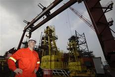 Johnathan Roberts, operations manager of S.D. Standard Drilling Plc., poses for photo on an oil drilling rig being built at the Keppel FELS shipyard in Singapore October 12, 2012. REUTERS/Tim Chong