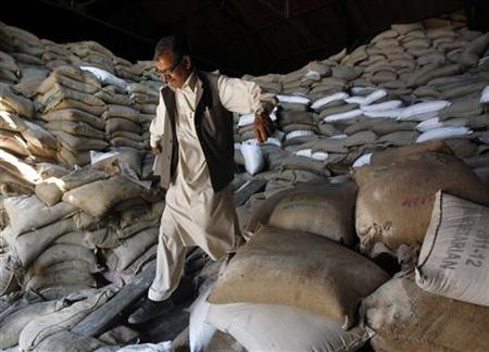 A Kashmiri worker walks down from the sacks of sugar inside a government godown in Srinagar September 14, 2012. REUTERS/Fayaz Kabli/Files