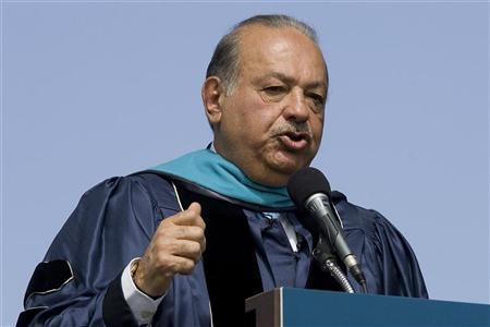Mexican billionaire Carlos Slim, who controls telecom giant America Movil, delivers remarks after receiving an honorary degree during commencement ceremonies for George Washington University on the National Mall in Washington, May 20, 2012. REUTERS/Jonathan Ernst