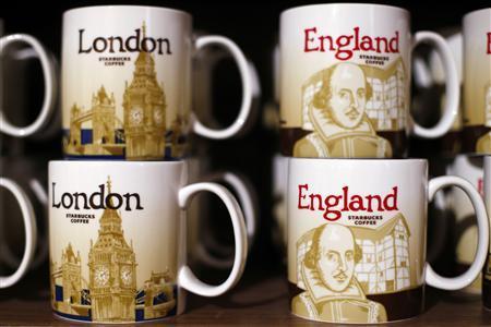 Branded coffee mugs are displayed on a shelf in Starbucks' Mayfair Vigo Street branch in central London September 12, 2012. Picture taken September 12, 2012. REUTERS/Andrew Winning