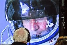 Pilot Felix Baumgartner of Austria is seen on a screen at mission control center in the capsule during the final manned flight for Red Bull Stratos in Roswell, New Mexico, in this October 14, 2012 handout photo. REUTERS/ Stefan Aufschnaiter/Red Bull Content Pool /Handout