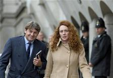 Former News International chief executive Rebekah Brooks and her husband Charlie leave the Old Bailey court in London September 26, 2012. REUTERS/Neil Hall