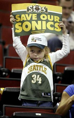 Seattle Supersonics fan Kayla Rydberg, 5, of Auburn, Washington, holds up a ''SOS: Save our Sonics'' sign before the start of their NBA game against the Dallas Mavericks at Key Arena in Seattle April 13, 2008. REUTERS/Anthony P. Bolante