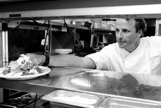 """American chef Marc Murphy serves up a dish from the kitchen of his restaurant """"Landmarc"""" in the Tribeca neighborhood of New York City in this undated handout photo. REUTERS/Marc Murphy/Handout"""