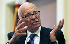 "News Corp Chairman and CEO Rupert Murdoch gestures as he speaks at the ""The Economics and Politics of Immigration"" Forum in Boston, Massachusetts August 14, 2012. REUTERS/Jessica Rinaldi"