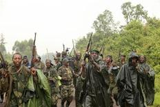 M23 rebel fighters dance in celebration in the rain at Rumangabo, after government troops abandoned the town, 23km (14 miles) north of the eastern Congolese city of Goma, July 28, 2012. REUTERS/James Akena