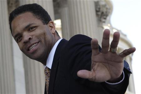 Rep. Jesse Jackson, Jr. (D-IL) waves on U.S. Capitol steps in Washington December 2, 2011. REUTERS/Yuri Gripas