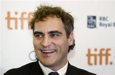 "Actor Joaquin Phoenix arrives on the red carpet for the gala presentation of the film ""The Master"" at the 37th Toronto International Film Festival, September 7, 2012. REUTERS/Mark Blinch"