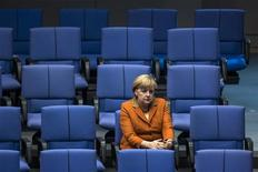 German Chancellor Angela Merkel attends a debate after delivering a government policy statement during a session of the Bundestag, the German lower house of parliament, in Berlin October 18, 2012. REUTERS/Thomas Peter