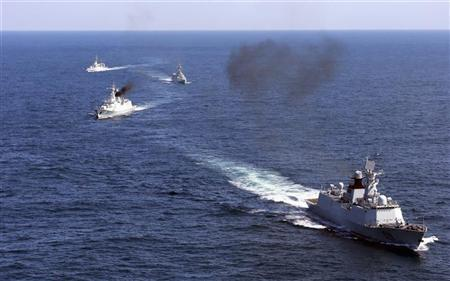 Vessels roam the waters of East China Sea during a naval drill, October 19, 2012. REUTERS/China Daily (CHINA)