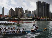 Participants compete in a dragon boat race to mark the annual Tuen Ng or Dragon Boat Festival at Hong Kong's Aberdeen fishing port June 6, 2011. REUTERS/Bobby Yip