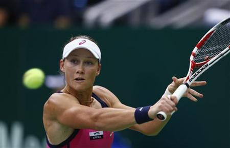 Australia's Samantha Stosur hits a return against Serbia's Ana Ivanovic during their Kremlin Cup semifinal tennis match in Moscow October 20, 2012. REUTERS/Grigory Dukor