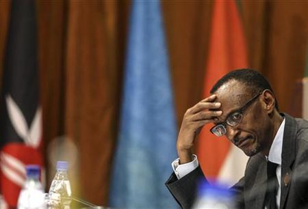 Rwanda's President Paul Kagame listens to deliberations during the International Conference on the Great Lakes Region (ICGLR) at the Commonwealth Resort Hotel Munyonyo in the Ugandan capital of Kampala August 8, 2012. REUTERS/Edward Echwalu/Files
