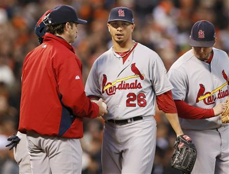 Cardinals beaten by bad bounce, silent bats