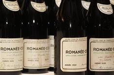 A superlot of 55 bottles of every vintage of Domaine Romanee Conti (DRC) released between 1952 and 2007, with the exception of 1968 which was never released, are shown at an auction preview in Hong Kong December 7, 2011. REUTERS/Bobby Yip
