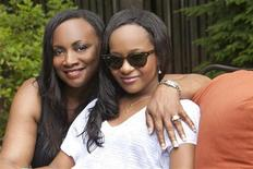 "Pat Houston (L), sister-in-law of the late singer Whitney Houston, and Houston's daughter Bobbi Kristina are shown in this undated publicity photograph from the new Lifetime cable channel reality series, ""The Houstons: On Our Own"" premiering on Lifetime October 24, 2012. REUTERS/Richard Knapp/Copyright 2011/Lifetime/Handout"